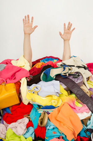 Man Buried Under Colorful Clothes