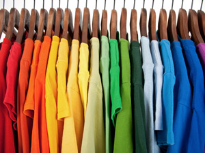 Organized Colored Shirts on Wooden Hangers